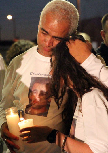 Courtesy David Santiago Miami Herald_Carlos Aguilar at vigil for his son_375px_CDiv0.St